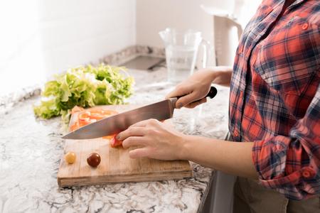 Woman Cutting Salad Banco de Imagens