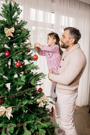 Father and Child Preparing for Christmas