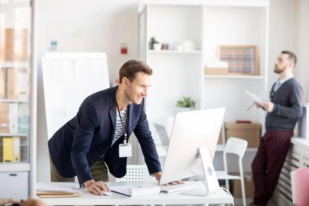 Smiling Businessman using Computer