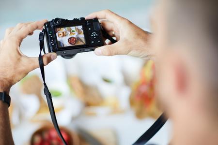 Photographer Holding Digital Camera