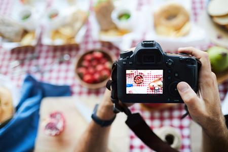 Unrecognizable Photographer Holding Camera
