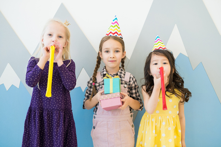 Having fun at childrens birthday party Stock Photo