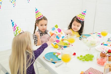 Little friends congratulating birthday girl