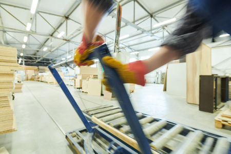 Man regulating roller conveyor