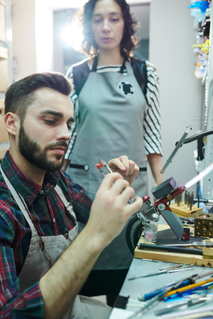 Male Artisan Doing Glasswork Stock Photo