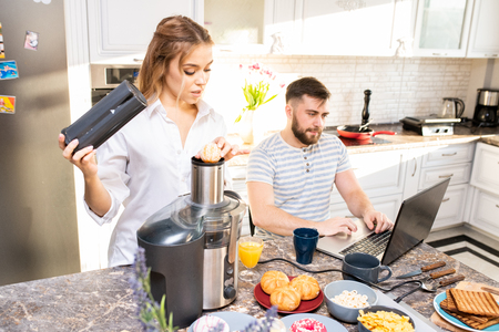 Modern Young Couple in Kitchen