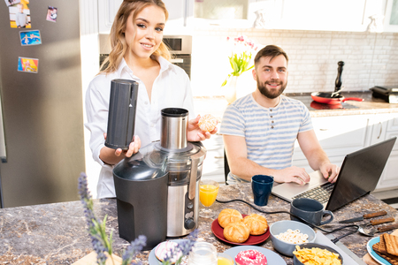 Smiling Young Couple in Kitchen Stock Photo
