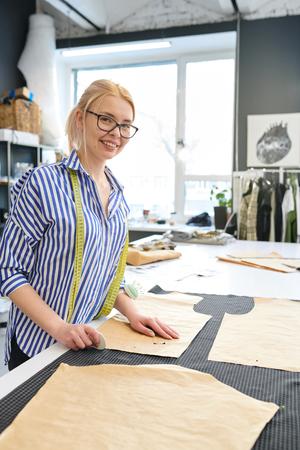Female designer sewing dress