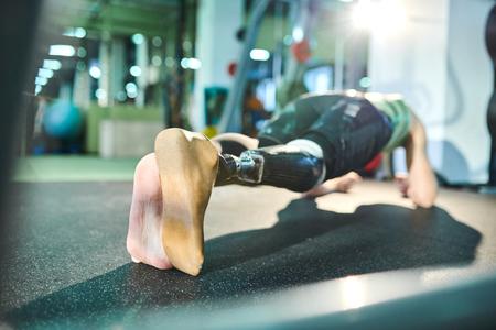 Man of spirit practicing plank exercise
