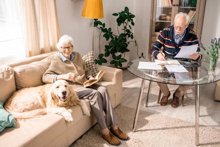 Happy Senior Couple with Family Pet Banco de Imagens