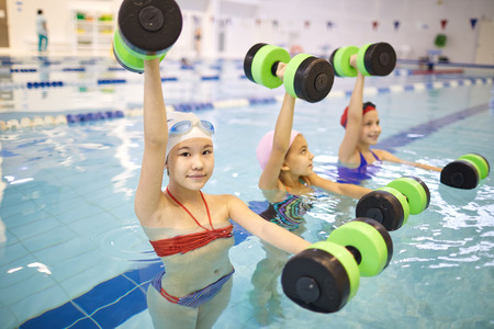 Girls doing sport in pool