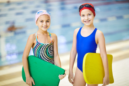 Girls in swimming pool Stock Photo - 116250495