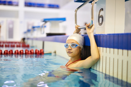 Girl doing exercises in the water