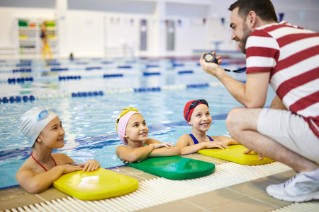 Training in the swimming pool Stock Photo