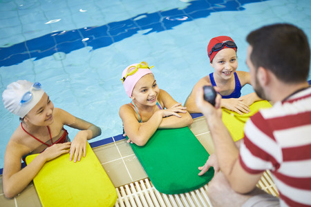 Little girls at swimming lesson