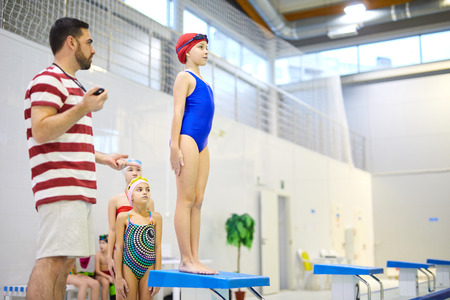 Group of swimmers at sport training Stock Photo