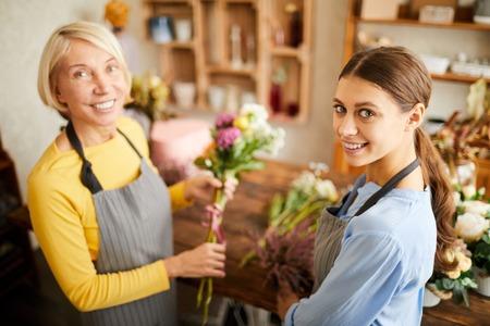 Florists Posing in Flower Shop Banco de Imagens
