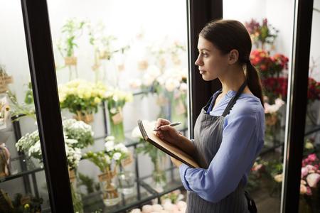 Female Florist Choosing Flowers