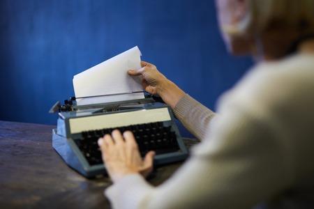 Novelist Using Typewriter Stock Photo