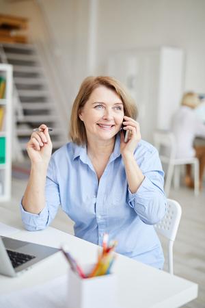 Mature Businesswoman Speaking by Phone