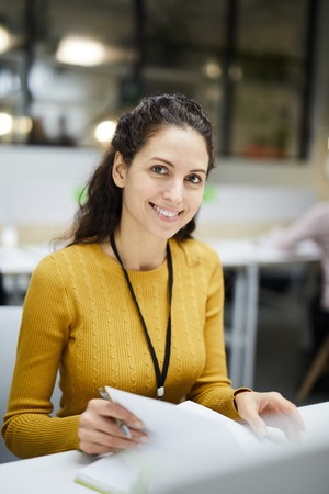 Attractive woman planning timetable Stockfoto
