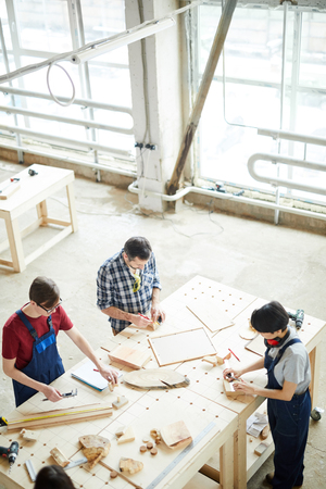 Busy carpenters producing furniture