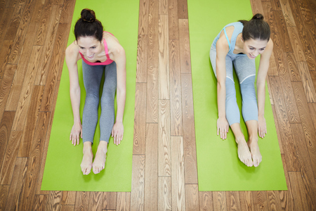 Two Women Stretching Above View