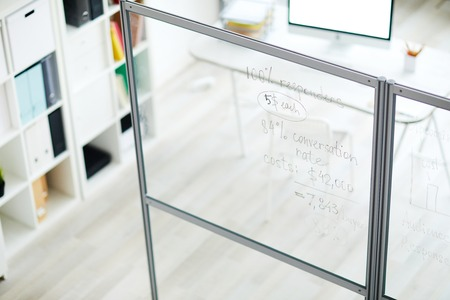 Background image of financial calculations written on glass wall in modern office, copy space Banque d'images - 116776657