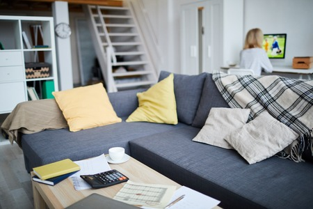 Background image of modern studio apartment interior with unrecognizable woman, copy space Stockfoto