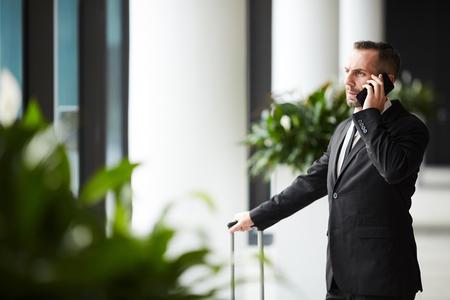 Business traveler calling Stock Photo