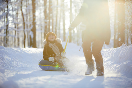Happy Girl Enjoying Sleigh Ride Stock Photo