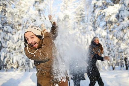 Family Having Fun in Winter Park Stock Photo