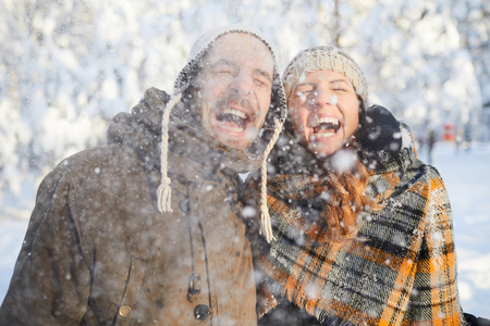 Couple Enjoying Snowfall