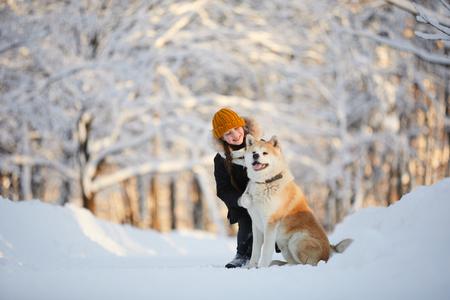 Girl Posing with Akita Dog Banco de Imagens