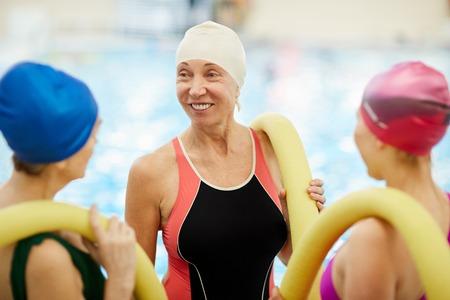 Senior Women Chatting by Pool