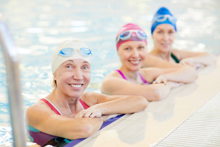 Three Mature Women Posing in Pool
