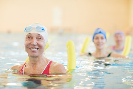 Happy Women Working Out in Water Stock Photo
