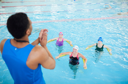 Fitness Class in Swimming Pool Imagens