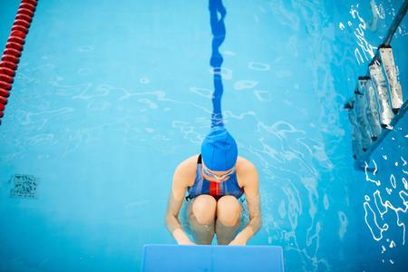Professional Swimmer in Water Reklamní fotografie