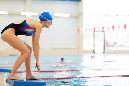 Female Swimmer on Start Stock Photo