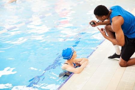 Woman Talking to Guard in Pool 写真素材