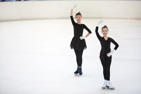 Two Figure Skaters Posing in Competition Stok Fotoğraf