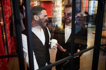 Two Gentlemen by Window in Restaurant