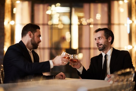 Celebrating Deal in Restaurant Stok Fotoğraf