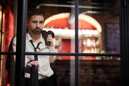 Drunk Man Leaving Bar Stock Photo