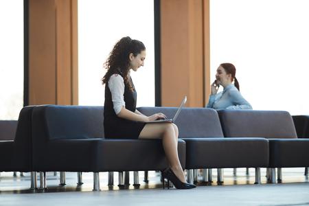 Businesswoman using Laptop in Lobby