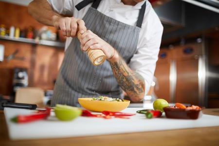 Chef Salting Dish Stock Photo