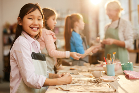 Smiling Asian Girl in Pottery Studio