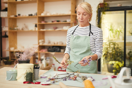 Female Florist Making Decorations Stock Photo