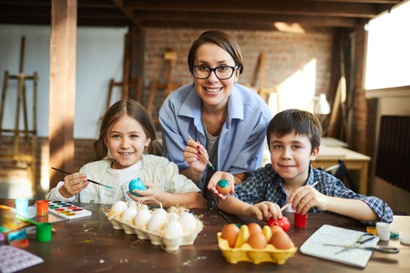 Happy Family Painting Easter Eggs Stock Photo - 119553892